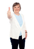 Smiling old lady showing thumbs up gesture royalty free stock photography