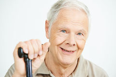 Smiling old man with cane Stock Photo