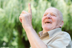 Smiling old man stock photos