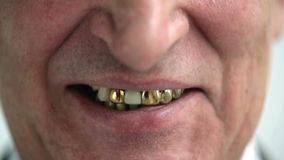 Smiling old man with gold teeth stock footage