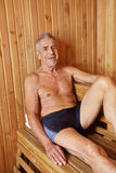 Smiling old man in sauna Stock Image