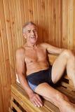 Smiling old man in sauna Stock Image