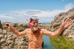Smiling old man talks after snorkelling Stock Photos