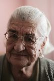 Smiling old mature woman. Portrait of a old woman with a strong facial expression of many Royalty Free Stock Images