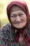 Smiling old woman. Wearing a traditional headscarf stock photo