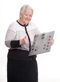 Smiling old woman with a bathroom scale Stock Photo