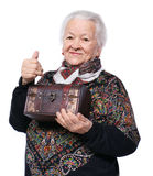 Smiling old woman with casket. Showing yes sign on a white background Stock Photos