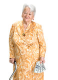 Smiling old woman holding money in hands Royalty Free Stock Images