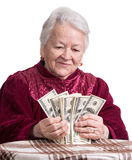 Smiling old woman holding money Royalty Free Stock Images