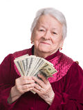 Smiling old woman holding money Royalty Free Stock Photo