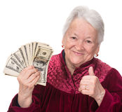 Smiling old woman holding money Royalty Free Stock Photos