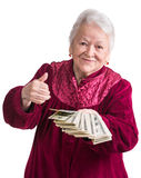 Smiling old woman holding money Royalty Free Stock Photography