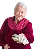 Smiling old woman holding money Royalty Free Stock Image