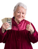 Smiling old woman holding money Stock Photo