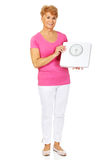 Smiling old woman holding weight scale Stock Photos