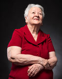 Smiling old woman looking up Royalty Free Stock Photography