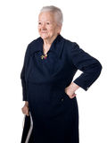 Smiling old woman sitting with a cane Royalty Free Stock Photo
