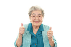 Smiling old woman. With thumbs up Royalty Free Stock Image