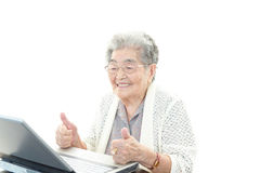 Smiling old woman with thumbs up royalty free stock photo