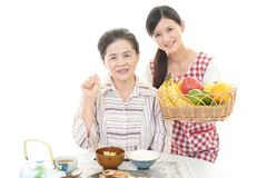 Old woman eating meals royalty free stock photo