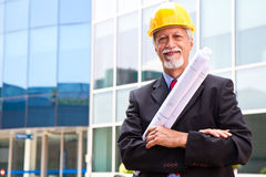 Smiling older architect looking out Royalty Free Stock Image