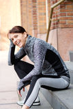 Smiling older sports woman resting outside Royalty Free Stock Images