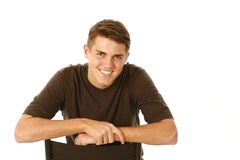 Smiling older teen boy. Isolated on white royalty free stock image