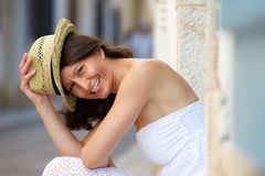 Smiling older woman with hat outside Stock Photos