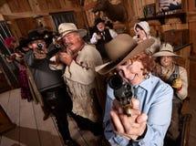 Smiling Older Woman Points Gun Stock Photos