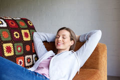 Smiling older woman relaxing at home Royalty Free Stock Image
