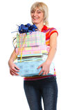 Smiling older woman with stack of present boxes Royalty Free Stock Images