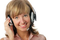 Smiling operator. Pretty blondy woman with headset royalty free stock image