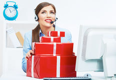 Smiling operator seat at table with red gift box. Happy busines Stock Photos