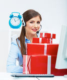 Smiling operator seat at table with red gift box. Happy busines Stock Images