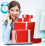 Smiling operator seat at table with red gift box. Happy busines Stock Image
