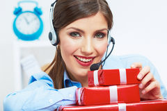Smiling operator seat at table with red gift box. Happy busines Royalty Free Stock Image