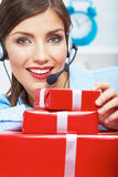 Smiling operator seat at table with red gift box. Happy busines Stock Photo