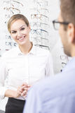 Smiling optician saleswoman Royalty Free Stock Image