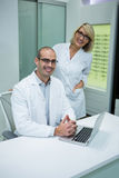 Smiling optometrists in ophthalmology clinic. Portrait of smiling optometrists in ophthalmology clinic Stock Photos
