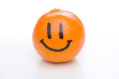 Smiling orange mandarin or tangerine fruit Stock Images