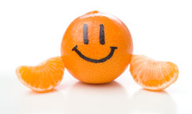 Smiling orange mandarin or tangerine fruit. Isolated on white background Stock Images