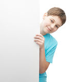 Smiling oung boy with a sheet of paper Stock Photography