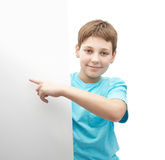 Smiling oung boy with a sheet of paper Royalty Free Stock Photography