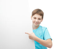Smiling oung boy with a sheet of paper Stock Image