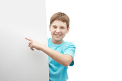 Smiling oung boy with a sheet of paper Stock Photos