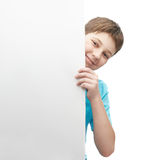 Smiling oung boy with a sheet of paper Royalty Free Stock Photo