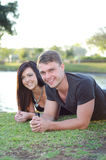 Smiling outdoors. Young, good looking, couple smiling outdoors Stock Image