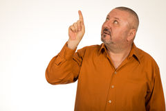 Smiling overweight male pointing up Stock Photo