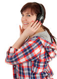 Smiling overweight teenage girl in headphones Stock Images