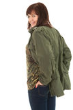 Smiling overweight teenage girl in military jacket Royalty Free Stock Photo